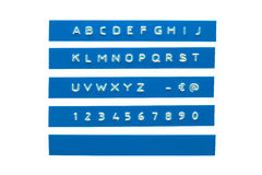 Embossed alphabet on blue plastic tape Royalty Free Stock Image