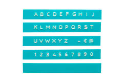 Embossed alphabet on cyan plastic tape Stock Photos