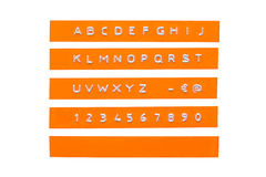 Embossed alphabet on orange plastic tape. Isolated on white royalty free illustration