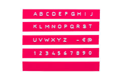 Embossed alphabet on pink plastic tape Stock Photos
