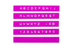 Embossed alphabet on purple plastic tape Royalty Free Stock Photo