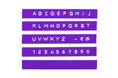 Embossed alphabet on violet plastic tape Stock Photography