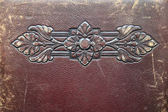 Embossed antique leather. Worn antique leather with embossed design Royalty Free Stock Images