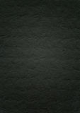 Embossed black paper texture background Royalty Free Stock Images
