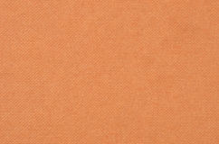 Embossed cardboard paper background. Embossed cardboard background, brown color, close up Stock Photos