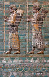 Embossed Colorful Achaemenid Soldiers from Susa of Iran. Colorful glazed brick frieze of Persian Achaemenid warriors from Susa of Iran stock image