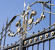 Embossed decoration on the iron gates Stock Photos