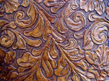 Embossed Engraved Leather. Texture with floral leaf design royalty free stock photos