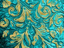 Embossed Engraved Leather Blue Gold Stock Image