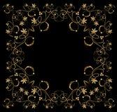 Embossed filigree golden frame on black background. Stock Photo