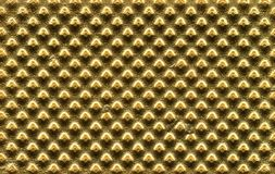 Embossed gold metal texture background. Embossed gold metal texture useful as a background stock photography