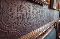 Embossed historic wallpaper. Antique wallpaper close-up with embossed motifs Stock Photography