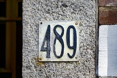 House number four hundred and eighty nine 489. Embossed house number four hundred and eighty nine 489 Stock Photography