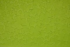 Embossed light green carton paper. Background of shamrock. Extreme closeup Stock Photography