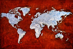 Embossed metal relief of the world map Stock Images