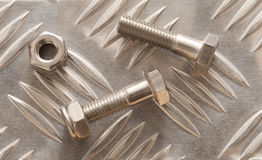 Embossed metal sheet with nuts and bolt Stock Images