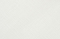 Embossed paper background. White color, close up stock photography