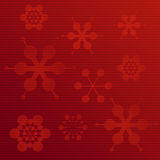 Embossed paper snowflake background on red Stock Photography