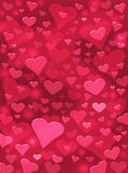 Embossed Red Hearts. Floating heart shapes on a textured red paper background.  Image displays a pleasing paper grain and texture at 100 percent Royalty Free Stock Image