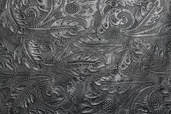 Free Embossed Shiny Black Leather With The Floral Motifs Stock Image - 143986601
