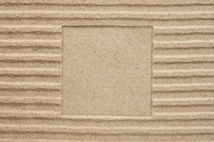 Embossed square in the sand Royalty Free Stock Photo