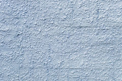 Embossed stucco grayish-bluish surface closeup. Royalty Free Stock Images