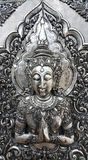 Embossed thai angle on silver plate in temple, Thailand Stock Images