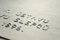 Embossed writing for blind people Royalty Free Stock Photo