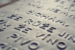 Embossed writing for blind people Stock Photo