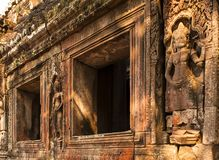 Embossment in Angkor Wat. Embossment and windows in Angkor Wat stock photography