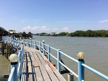 Embouchure bridge with restaurant and houses in the fishing vill. Age Thailand Royalty Free Stock Images