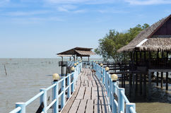 Embouchure bridge with restaurant and houses in the fishing vill. Age Thailand Royalty Free Stock Photos