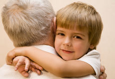 Embrace. Little boy embrace his grandpa Royalty Free Stock Image