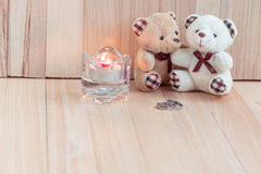 Embrace Bears in love, propose Engage ring sit near Candlestick Stock Images