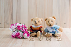 Embrace Bears in love, sit near bouquet rose. Royalty Free Stock Photos