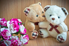 Embrace Bears in love, sit near bouquet rose Stock Images