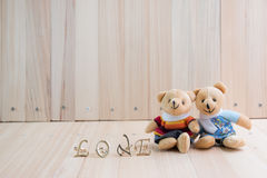 Embrace Bears in love, sit near bouquet rose. Stock Images