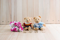 Embrace Bears in love, sit near bouquet rose. Royalty Free Stock Images