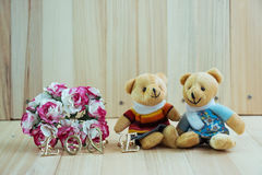 Embrace Bears in love, sit near bouquet rose royalty free stock image
