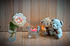 Embrace Bears in love, sit near Candlestick and pastel Rose Stock Images