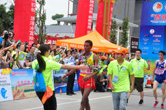 Embrace the bronze athletes. Athletes won the third place hug congratulations.Half international marathon in fushui county in yunnan province in China, time: on Royalty Free Stock Photography