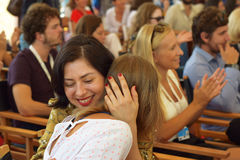 Embrace in the crowd. Taken at Sarajevo Film Festival in August 2016. Crowd is made of young actors and film makers attending one of the awards ceremonies. A stock photography
