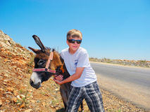 In an embrace with a donkey. stock photography