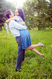 Embrace of happy couple outdoor Stock Images