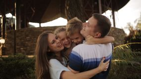 The embrace of a happy family in the Park at sunset. stock video