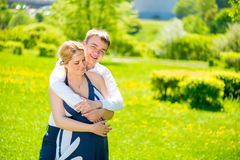 Embrace of the man she loved and future dads Stock Photography