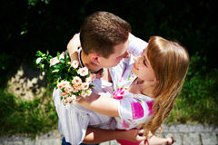 Embrace romantic lovers. On summer landscape Stock Photos