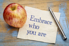 Embrace who you are. Handwriting on a napkin with a fresh apple Royalty Free Stock Image