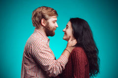 The embrace of young man and woman. The embrace of young men and women on blue studio background Stock Photography