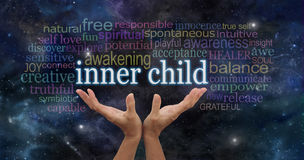 Embrace your Inner Child. Female hands stretching up palms open with the words INNER CHILD floating above surrounded by a relevant word cloud on a dark blue royalty free stock images